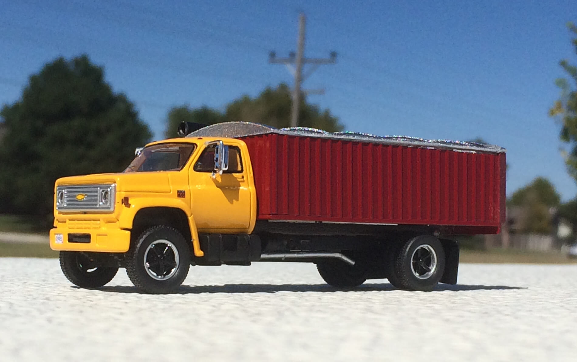 Yellow truck with red dump bed